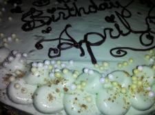 Pistachio green pearls adorn pistachio buttercream cake