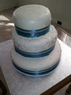 White fondant blue and silver ribbon wedding cake Hawaii