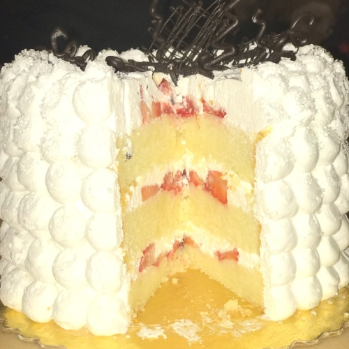 Buttercake with strawberry and whipped cream filling
